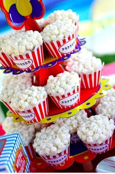 """""""popcorn"""" cup cakes...made cupcakes like it said on box. frost with white vanilla cup cakes. and topped each one with 30 mini marshmallows, each cut 2/3 through and arranged them on top of cup cake. Final touch was to dust marshmallows with yellow colored sugar."""