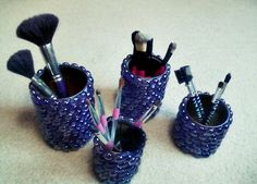 Successfully covered my makeup brush holders! finally. hot glue gun didn't work, and neither did E6000, at first. I just had to have a blow dryer on  to dry the glue at the same time I was applying. Worked perfectly. The first time I used it, all the bead gem things kept moving and would eventually just fall off completely. E6000 + Blow dryer for the win