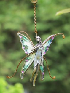 A garden Faerie, all true Witches have real faeries living in their gardens so we must always be sure to provide for them