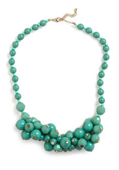 Like the color. But do the gold fasteners on the beads call to mind tiny nipples?!?