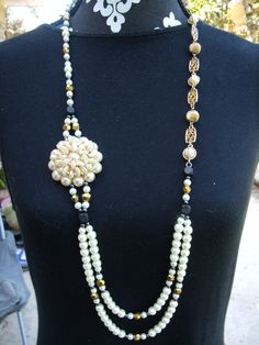Double strand asymmetrical glass pearl and chain necklace with side pearl pendant. $17.95