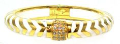Angelique De Paris Mata Hari Vermeil 18K Gold Finish Resin Bangle Bracelet in White Angelique De Paris. $429.95. Fits up to 8 inch wrist.. Genuine White Topaz gemstone center station, gentle pull apart clasp with spring hinge for easy on/off. White Glossy Resin. 1/2 inch wide and stackable.. 18K Gold finish Exotic Scroll Print Bangle Bracelet in .925 Sterling Silver. Designed by Angelique De Paris with her signature resin of unequalled craftsmanship.