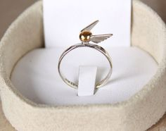 Harry Potter ring ($39.75). | 34 Impossibly Clever Pieces Of Jewelry Inspired By Books
