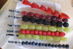 Fruit lightsaber skewers are a healthy Star Wars birthday party treat: Single type of fruit on a wooden skewer, duct tape handle decorated with sharpie