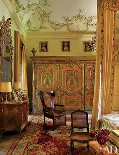 Gianni Agnelli's onetime bedroom on the piano nobile features a painted Piedmontese armoire; a Charles X Savonnerie carpet softens the terrazzo floor.