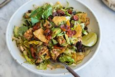 Vegan Tempeh Taco Salad - All the things you love about a taco, in salad form. Crushed tortilla chips bring the crunch, black beans and crumbled tempeh coated with taco seasoning brings the substance, and a strong, smoked paprika-apple cider dressing pulls everything together. - from 101Cookbooks.com