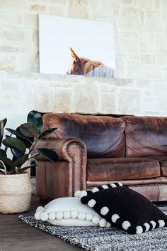 Pampa Monte Neutral rug & cushions handmade in Argentina and a Pampa Horse print. Photo: Victoria Aguirre. Styled by Courtney Reeman