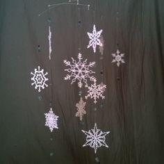 Crocheted snowflake mobile