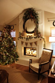 Christmas winter themed fireplace, mantel, living room, noel bunting  Candles in fireplace
