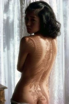 Is that really a shadow? Absolute sexiness regardless. A yummy mix of boudoir, urban, tradition and innocence.