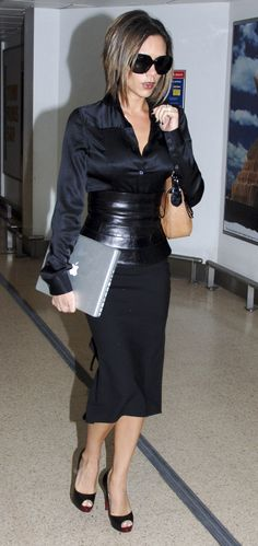 Victoria Beckham in pencil skirt and corset belt. I think a skirt just beneath…