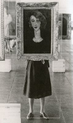 Lina Bo Bardi, 1957-8, São Paolo Museum of Art — behind one of her innovative glass painting stands displaying Modigliani's Renée, 1917, from the museum's collection.