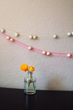 "cute new garland: 1"" wooden beads + string or yarn.  can paint the beads or add letters!"