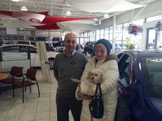 Used Car Manager Cristian Coroian with the Greater Milwaukee Auto Show Ticket Winner in February of 2015.