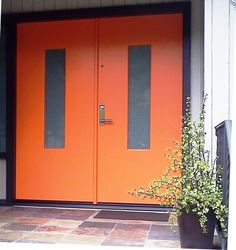 We love this bold color choice on this modern door. Custom designed TM Cobb double entry door.  Emtek locks