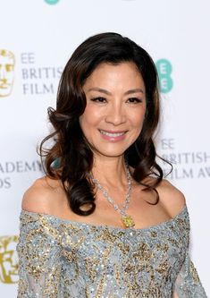 Michelle Yeoh Photos - Michelle Yeoh poses in the press room during the EE British Academy Film Awards at Royal Albert Hall on February 2019 in London, England. Korean Beauty Girls, Asian Beauty, Anthology Film, Michelle Yeoh, Middle Aged Women, Movie Shots, British Academy Film Awards, Elie Saab Couture, Embellished Gown