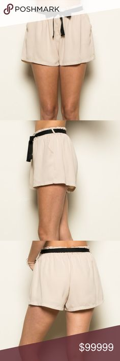 Coming Soon - Pocket Shorts Taupe shorts with pockets and drawstring. Relaxed fit and lightweight. Material is 100% polyester. Like to be notified when it arrives. Vega Boutique Shorts