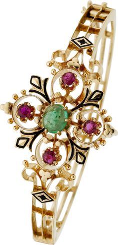Victorian Revival Emerald, Ruby, Enamel, Gold Bracelet The hinged bangle features an emerald cabochon weighing approximately 0.90 carat, enhanced by round-shaped rubies weighing a total of approximately 0.80 carat, set in 14k gold, accented by black enamel