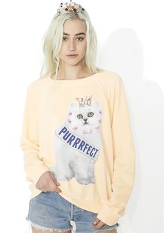 Wildfox Couture Purrfect Sommers Sweater yew don't need an award to tell you how perfect yew are, babe. Own it in this cozy sweater that features a light peachy orange construction, round neckline, long sleeves, and a cute lil graphic on da front of a pretty kitty who just won da pageant.