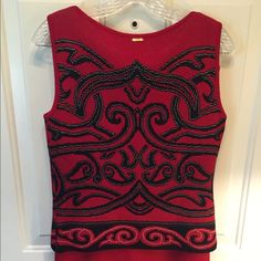 St Johns piece wool ensemble (pants, shell, skirt) St Johns collection by Marie Gray size 6 (small).  It's a vibrant Valentine's Day red ensemble including a long skirt, dress pants, and jacket.  The jacket is red and black.  Comfortable wool.  Purchased at Saks for approximately $1100 Selling this together, but make an offer if you are interested in only one piece.  Thanks ! St. John Pants Wide Leg
