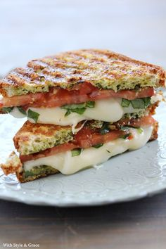 Source: http://prettyfoods.tumblr.com/post/53928305650 Panini--contents look like mozzarella, thinly sliced tomato, and scallions.