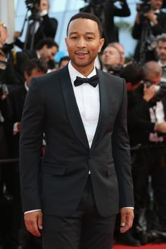John Legend in a Gucci Made to Order midnight blue shawl lapel tuxedo at the 68th Annual Cannes Film Festival.