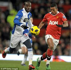Pascal Chimbonda (left) in action against Manchester United