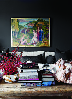 Dark walls and colorful art make for a winning decor scheme in this living room.