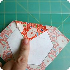 English paper-piecing hexagons - use a paper clip to hold that first fold