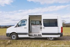 The UK-based van conversion company This Moving House designed a guest bed that pulls out like a drawer. Rv Campers, Camper Van, Van Conversion Dog, Dog Hiking Gear, Sprinter Camper, Pet Friendly Hotels, Van For Sale, Leg Work, Two Dogs