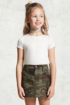 Forever 21 Girls - A knit skirt featuring an allover camo print, slanted front pockets, a flap pocket on each side, a zipper front, baste-stitch back pockets, a partially elasticized waist, and a button fly. Matching jacket available.