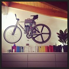 Hang your bike on the livingwall like Matteo    Adjust, Organize, Personalize.    #bookshelf #cinelli #cinellifamily #homesweethome #homedecor #books #bikestorage #bikewallmount #velo #singlespeed #cyclinglife #interiordesign #decor #bikedock #design #productdesign #fixie #rapha #roadbike #triathlon #igerscycling #cyclingshots #cyclingphotos #cyclo #baaw #bici #urbanlifestyle