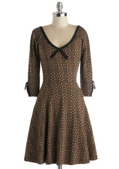Meet and Treat Dress, #ModCloth   Eager for some coffee & enlightening conversation with your bestie, you stroll to her fave coffeehouse in this printed dress by Effie's Heart! Santa Clara-based designer Effie's Heart crafted this Pima-cotton-blend piece to your winsome wardrobe's benefit. As lovely as the sweets in the bakery case, this black & beige garment showcases a lacy print, 3/4-length sleeves, & a bow accent atop its V-neckline. $97.99
