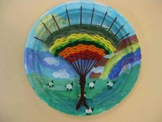 Gorgeous Paper Plate Weaving - Rainbow Tree Landscape. How very pretty! https://cassiestephens.blogspot.co.uk/2013/04/in-art-room-tree-weaving-with-third.html