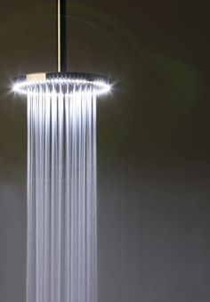 Ceiling mounted showerhead by Rain Therapy
