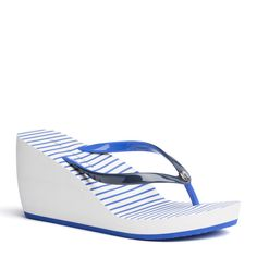 Fashion meets casual beach style with these wedge flip flops. Sleek strap is gathered with Tommy Hilfiger logo at the centre. EVA insock with logo print, EVA foam heel and rubber outsole for a soft, cushioned feel.