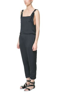 LONG DUNGAREES WITH LOW NECKLINE AT THE BACK