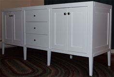 Shaker Style Double Sink Vanity with four doors and three drawers