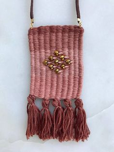 This woven necklace was handmade in Atlanta, Georgia. All necklaces are hand woven with embroidery thread and beads then assembled by myself with jump rings, a lobster clasp, fold-over crimps, and a suede leather cord. This is the perfect statement piece for your jewelry collection.