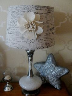 use a magnet on the back of decorations to temporarily decorate a lampshade