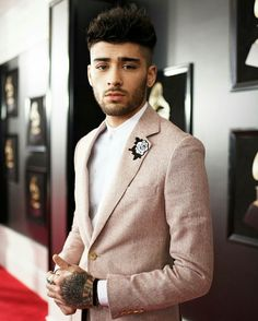 Zayn Malik Wearing a mauve Richard James Spring suit with a white Time's Up rose patch.