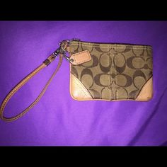 Coach Small Brown & Tan Monogram Wristlet Small wristlet. Great for keeping coins or money in a bigger bag. Slightly used. See pictures for flaws/stains. Like all other of my items, 100% authentic.  No trades  Coach Bags Clutches & Wristlets