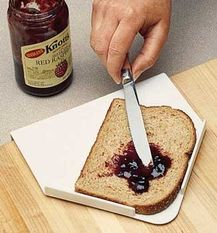 The Spreadboard holds bread in place while spreading jam, butter, or whatever you choose. Two plastic guards hold bread in place. A lip on the back edge hooks over the work surface to keep the Spreadboard from moving during use