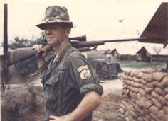 """Soldier posing with a sniper rifle and a """"sniper""""'patch on his arm ~ Vietnam War Photo Vietnam, Vietnam War Photos, American War, American History, Usmc, Marines, Military History, Military Gear, Military Aircraft"""