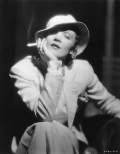 Publicity portrait of Marlene Dietrich Berlin-born actress famous for films such as Morocco and Blond Venus. She is shown here holding a cigarette, dressed in a tailored suit, with hat, bow-tie and cufflinks. Hollywood Icons, Vintage Hollywood, Hollywood Glamour, Hollywood Stars, Classic Hollywood, Marlene Dietrich, Divas, Rita Hayworth, Look Vintage