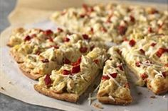 Artichoke hearts, seasoned mayo and roasted red peppers give this double-cheese pizza its amazing flavor.
