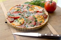 If you're like me, you believe that a fresh, ripe tomato is one of the best things about summer. And this tart is an ode