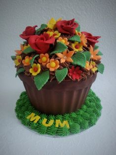 This cake reminds me of summer. A chocolate cake with chocolate buttercream and hand made decorations. This cake reminds me of summer. A chocolate cake with chocolate buttercream and hand made decorations. Large Cupcake Cakes, Big Cupcake, Giant Cupcakes, Pretty Cakes, Cute Cakes, Fancy Cakes, Cupcake Gigant, Flower Pot Cake, Gateaux Cake