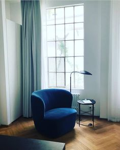 Inviting and calm atmosphere at the @august.the.boardinghouse hotel in Hamburg, Germany featuring the Stay Lounge Chair, TS Side Table and…