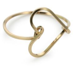 Gold heart ring, cute for a middle finger maybe...